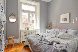 Преобладание серого цвета в интерьере спальни 9 квадратных метров