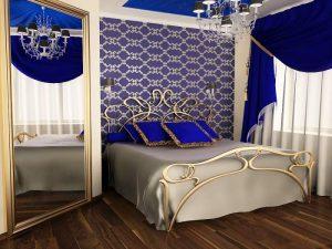 Большое зеркало идеально вписывается в стиль модерн для спальни