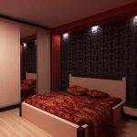 Интерьер небольшой спальни в красном колере