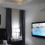 Как выбрать место для телевизора в спальне