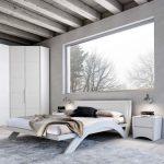 Нестандартная спальня выполненная в белом цвете