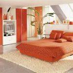Оранжевый цвет для оформления интерьера спальни