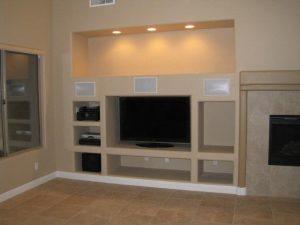 Гипсокартонный короб под телевизор в спальне